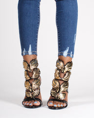 Skinny ankle jeans with gold designer heels