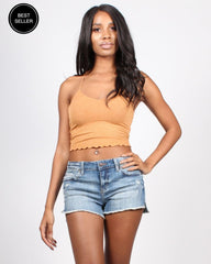 Pale orange cropped tank with denim cut-off shorts