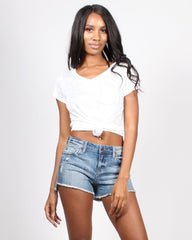White v-neck tee tied in the front with denim cut-off shorts