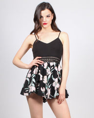 Women's romper with black spaghetti-strap top and floral-print bottom