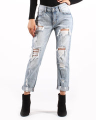 Loose-fit, distressed, cuffed-ankle jeans w/ black booties
