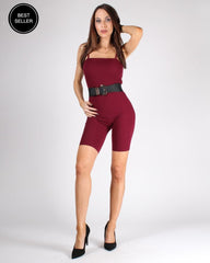 Body-hugging, wine-colored romper with wide, black belt