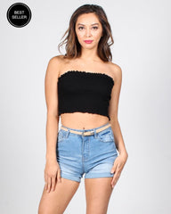 Black ruched tube top with high-waisted denim shorts and skinny belt