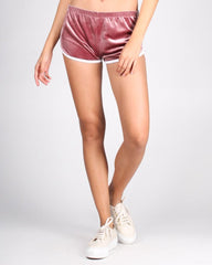 Pink velvet running shorts with sneakers
