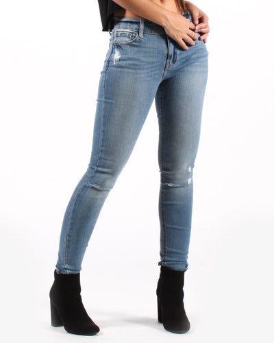 The Unforgettable Mid Rise Distressed Skinny Jeans
