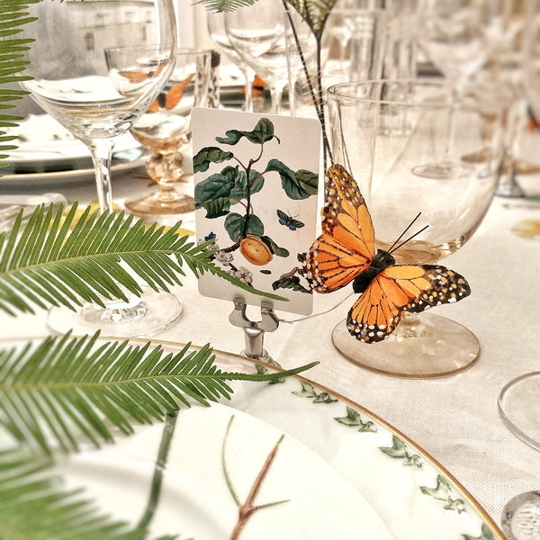 Mr. P's Place Cards on a wedding table with butterflies