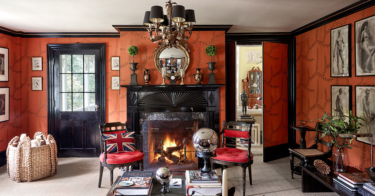 The Punctilious Mr. P's Place Card Co. Elle Decor October 2020 salon filled with antique and pattered wallpaper, fireplace, greek vase