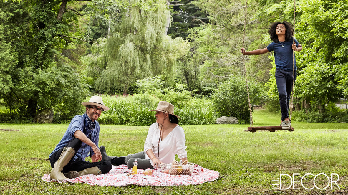 The Punctilious Mr. P's Place Card Co. | Martin Cooper & Karen Suen-Cooper in the garden with their son pax on the swing Elle Decor Magazine 2020