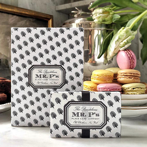 The Punctilious Mr. P's Place Card Co. signature gift box with macaroons and brownies