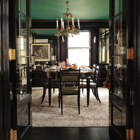 glamorous black lacquer dining room with a chinoiserie and neoclassical accents.