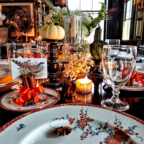 The Punctilious Mr. P's Place Card Co table set for the holidays with chinoiserie china, place cards, etched crystal glasses, art deco cutlery and candles