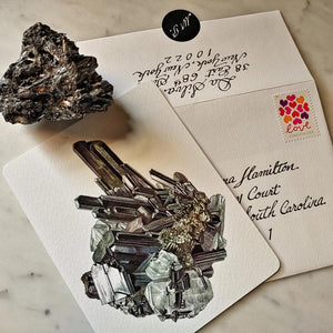 The Punctilious Mr. P's fine note card set on marble ledge with crystals on top showing personalized return address on envelope