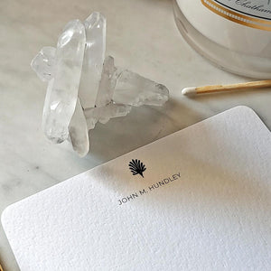 The Punctilious Mr. P's fine note card set on marble ledge with crystals on top showing personalized name on card's marquee