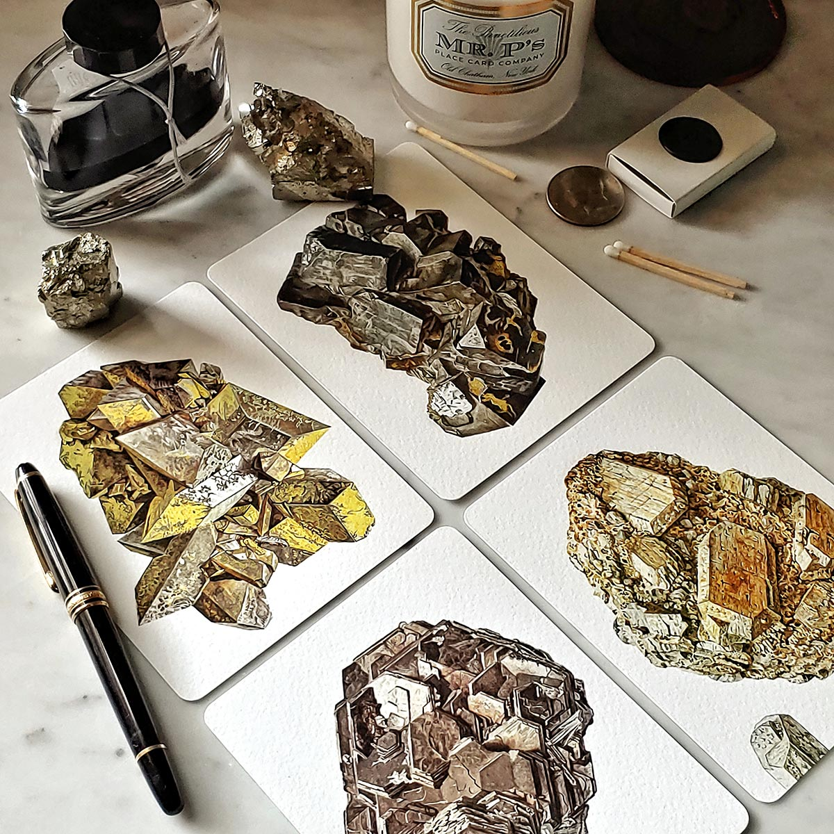 The Punctilious Mr. P's 'Minerals No. 2' note card set on marble ledge with crystals on top showing all 4 note cards