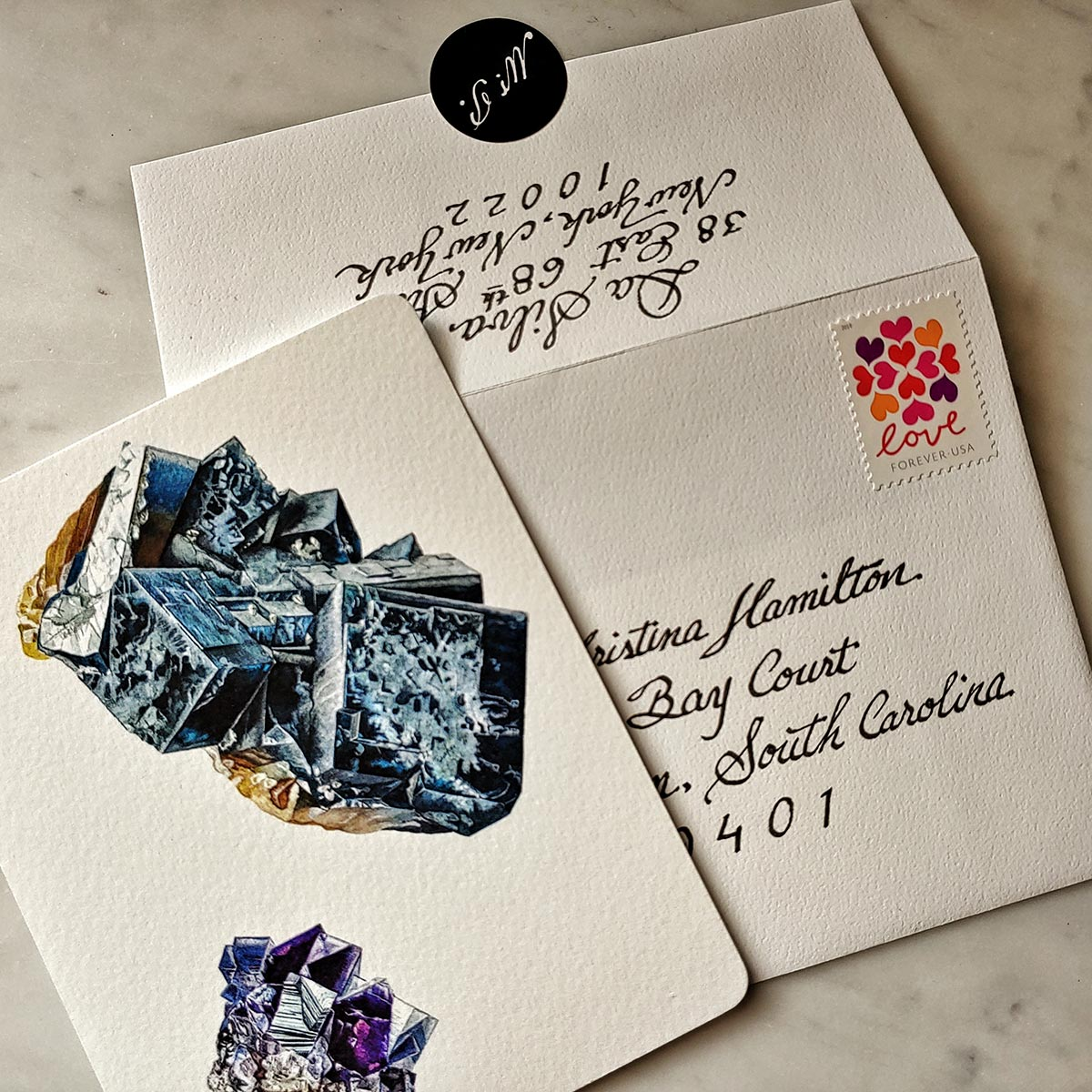 The Punctilious Mr. P's 'Minerals No. 4' fine note card on marble ledge with crystals on top showing the hand addressed envelope