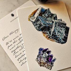 The Punctilious Mr. P's 'Minerals No. 3' fine note card on marble ledge with crystals on top showing the back of the card with digital calligraphy note