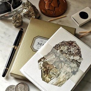 The Punctilious Mr. P's 'Minerals No. 5' note card set on marble ledge with crystals on top