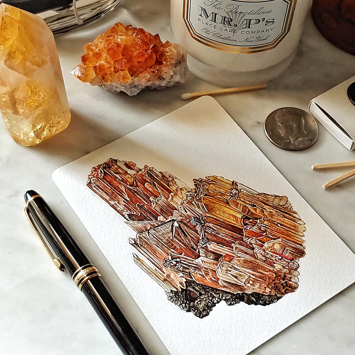 The Punctilious Mr. P's 'Minerals No. 6' note card set on marble ledge with crystals on top
