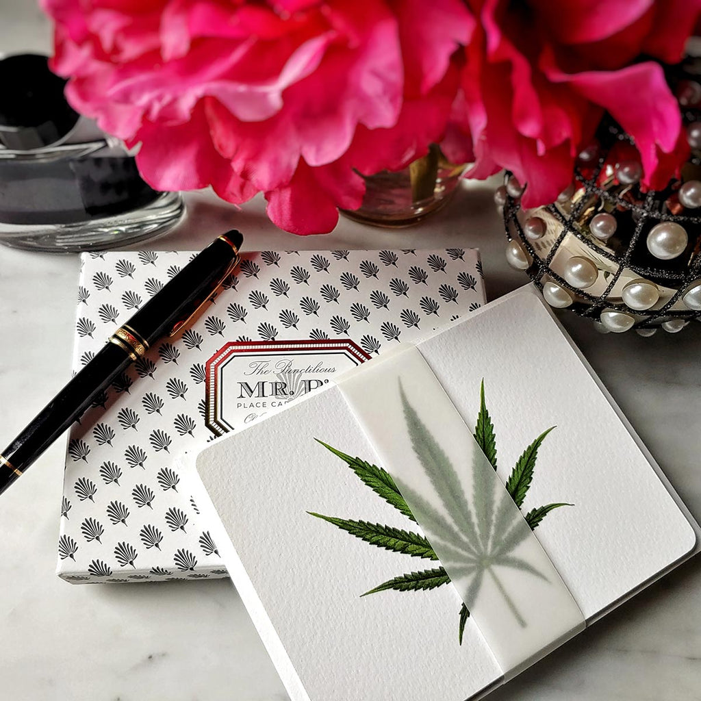 The Punctilious Mr. P's 'Cannabis' note card set on marble ledge with peony flower and fountain pen