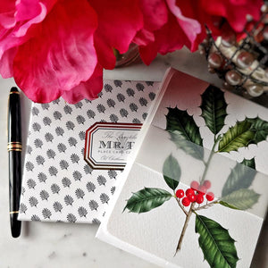 The Punctilious Mr. P's 'Holly' note card set on marble ledge with peony flower and fountain pen