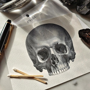 The Punctilious Mr. P's 'The Skull' note card pack with crystals laid around it, with personalized initials on the card