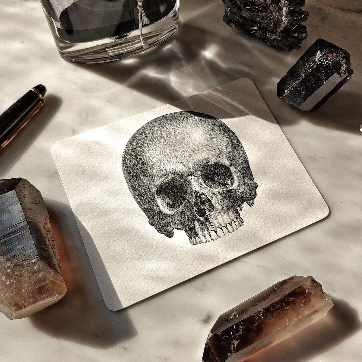 The Punctilious Mr. P's 'The Skull' note card with crystals laid around it
