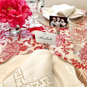 The Punctilious Mr. P's 'Cupid's Arrow' Valentine's Day place cards set on table with red floral cloth