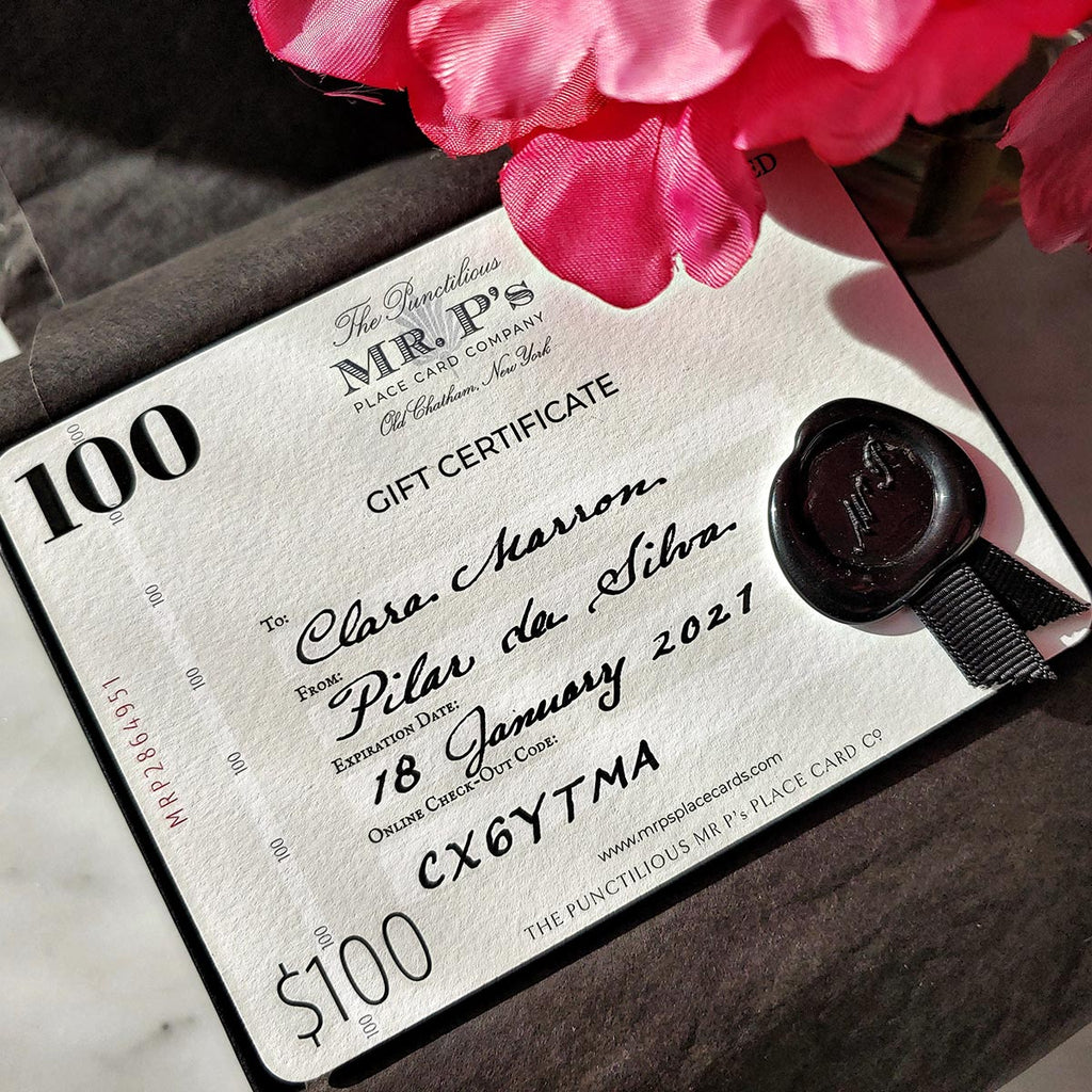 The Punctilious Mr. P's $100 Boxed Gift Certificate with wax seal and grosgrain ribbon whose design is inspired by vintage bank notes with recipient's name calligraphed by hand