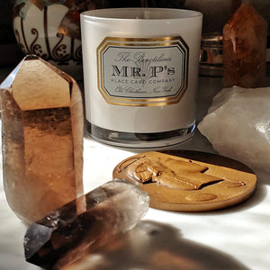 The Punctilious Mr. P's Twilight essential oils candle on marble top with healing crystals