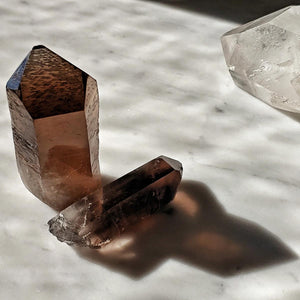 The Punctilious Mr. P's healing smoky quartz crystals on marble top