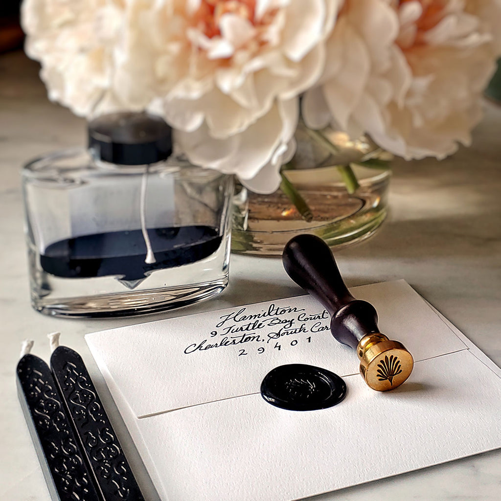 The Punctilious Mr. P's anthemion wax seal with 2 black wax sticks, ink bottle and beautiful vase of peony flowers