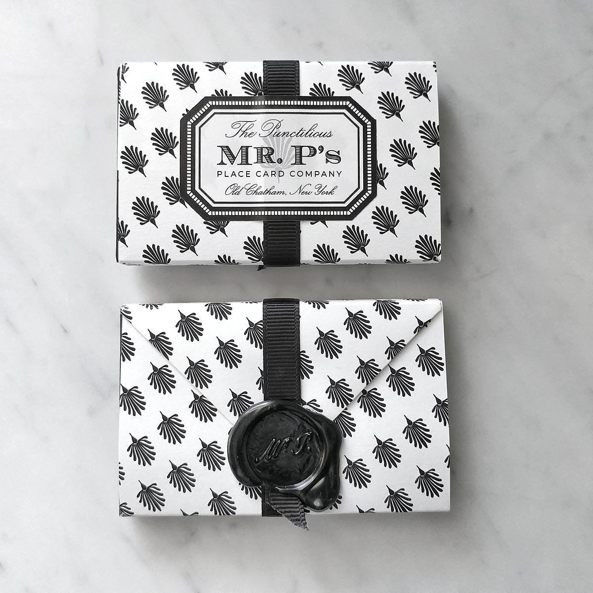A front and back view of a pack of Mr. P's Place Cards