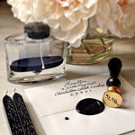 The Punctilious Mr. P's signature wax seal with 2 black wax sticks, ink bottle and beautiful vase of peony flowers