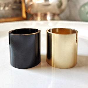 The Punctilious Mr. P's Gold Barrel Place Card Holder in both black and gold finish