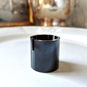 The Punctilious Mr. P's Gold Barrel Place Card Holder in black finish