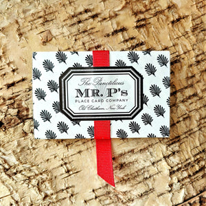The Punctilious Mr. P's Holiday packaging with red grosgrain ribbon