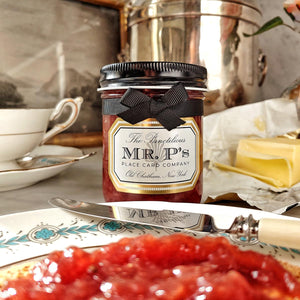 The Punctilious Mr. P's Place Card Co Strawberry Jam on buttered toast with tea.