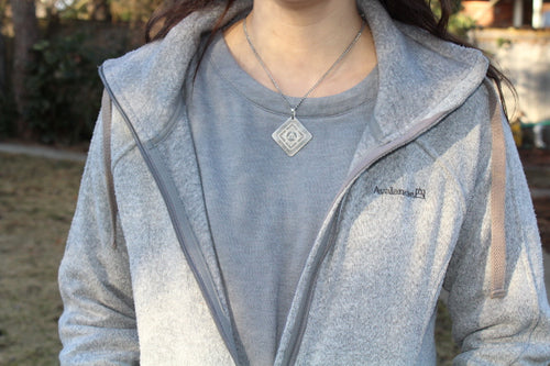 HelixLife Personal Pendant over thymus gland, gentle quantum energy to shield you from biostress and improve wellness.