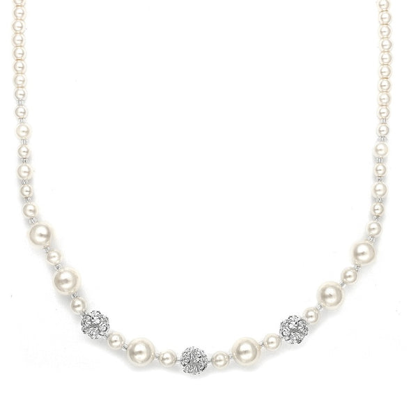 Mariell's popular wedding necklace features a lovely blend of assorted sized pearls highlighted with shimmering Austrian crystal rhinestone fireballs. sparkling crystals pearl setting gorgeous bridal accessories wedding necklace formal setting crystal clasp glowing diamonds wedding shop special necklace crystals rhinestones #bridalnecklace #weddingaccessories #utah #utahweddings #bridal #bride #formalnecklace #bridalshop #wedding #necklace #brideaccessories