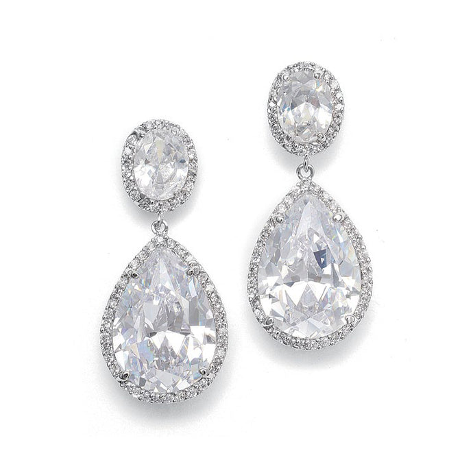 Mariell's beautiful bridal earrings feature pave framed ovals with a brilliant pear-shaped drop. This silver rhodium plated wedding earring measures 1 1/2