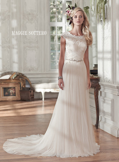 Comprised of barely-there tulle, this stunning sheath wedding gown sparkles with a delicate Swarovski crystal belt at the waist. Lace neckline cap-sleeves crystal buttons #utahbridalshop #weddinggowns #sandyutah #bridalcloset #brides #bridalshop #utahwedding #designerweddings #templeready #weddingaccessories #modestweddingdress