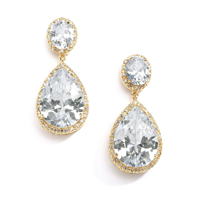 Stunning bridal gold earrings feature pave framed ovals with a brilliant pear-shaped drop. This silver rhodium plated wedding earring measures 1 1/2