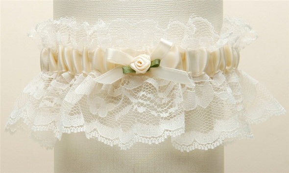 "Features antique Ivory ruffled lace with a center satin band and measure 2"" high. These garters are available in all white, all ivory, white with blue or ivory with blue. They come beautifully boxed and are hand-crafted in the USA. stunning classy satin band assortments available utah bridal store wedding shop special garter floral center baby pearls #bridalveil #weddingaccessories #utah #utahweddings #bridal #bride #formalveil #bridalshop #wedding #veil #brideaccessories"
