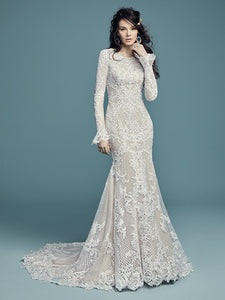 Lace motifs cascade over netting and tulle in this unique fit-and-flare modest wedding gown. Featuring a crew neckline, subtle V-back and long sleeves accented in bell cuffs. Lined with shapewear for a flattering fit, and zipper closure. #utahbridalshop #modestweddingdress #modest #longsleeves #bridalshop #bridalcloset #weddinggown #bride #lacegown #weddingdress #templeready