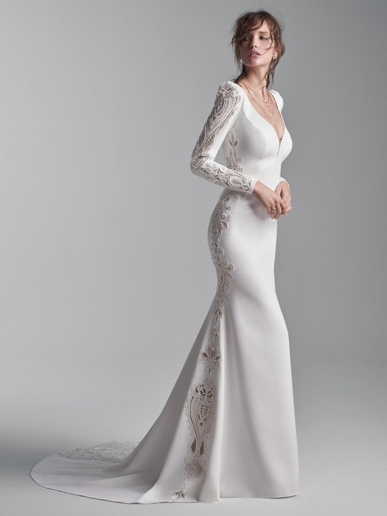 Obviously inspired by Renaissance it-girls. A long puff-sleeve V-back wedding gown for a sweet and sophisticated statement. Merona stretch crepe Soft V-back Deep illusion V-neckline Long Merona stretch crepe puff sleeves with illusion lace cut-out Lined with Serene stretch chiffon Crystal button over zipper closure#utahbridalshop #weddingdresses #weddingaccessories #bridalcloset #classyweddings #brides #utahweddings #designerweddinggowns #gorgeousgowns #trendyweddingdresses #uniqueweddinggowns