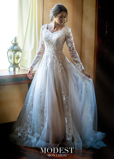 Light and airy Tulle and sequin lace A-line gown features modesty cap sleeves under lace illusion long sleeves, a scalloped soft sweetheart neckline, sequin lace appliques over the tulle bodice. zipper back, covered buttons, tulle skirt, sequin lace, horsehair hem, chapel train #utahbridalshop #modestweddingdress #modest #longsleeves #bridalshop #bridalcloset #weddinggown #bride #lacegown #weddingdress #templeready