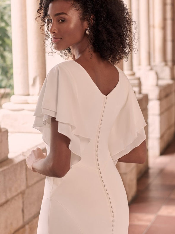 Blanca stretch chiffon Modest V-neck Modest scoop back Modern flutter sleeves Lined with Virtue stretch jersey for comfort Covered buttons over zipper closure Covered buttons trail down to hemline. #utahbridalshop #weddinggowns #sandyutah #bridalcloset #brides #bridalshop #utahwedding #designerweddings #templeready #weddingaccessories #modestweddingdress