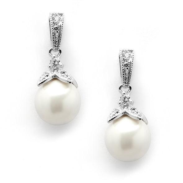 "Bridal or bridesmaid pearl drop earrings have antique silver pave CZ petals and soft cream pearls in a classic vintage silhouette. At 3/4"" high, these beautiful drop earrings feature 10mm glass-based shell pearls in a lustrous genuine mother of pearl finish. pearl earrings wholesale stunning silver stunning earrings bridal store wedding shop special sparkling #bridalearrings #weddingaccessories #utah #utahweddings #bridal #bride #formalearrings #bridalshop #wedding #earrings #brideaccessories"