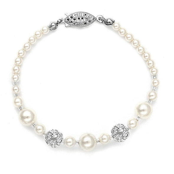 Mariell's popular wholesale wedding bracelet features assorted sized pearls highlighted with shimmering Austrian crystal rhinestone fireballs from Midvale Bridal Shop. sparkling diamonds pearl setting gorgeous bridal accessories wedding bracelet formal setting crystal clasp glowing diamonds wedding shop special bracelet crystals rhinestones #bridalcrystals #weddingaccessories #draperutah #utahweddings #bridal #bride #formalbracelet #bridalshop #wedding #bracelet #brideaccessories