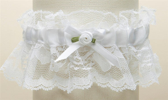 "Features antique white ruffled lace with a center satin band and measure 2"" high. These garters are available in all white, all ivory, white with blue or ivory with blue. They come beautifully boxed and are hand-crafted in the USA. stunning classy satin band assortments available utah bridal store wedding shop special garter floral center baby pearls #bridalveil #weddingaccessories #utah #utahweddings #bridal #bride #formalveil #bridalshop #wedding #veil #brideaccessories"